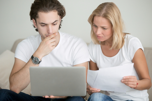 Couple doing tax deductions
