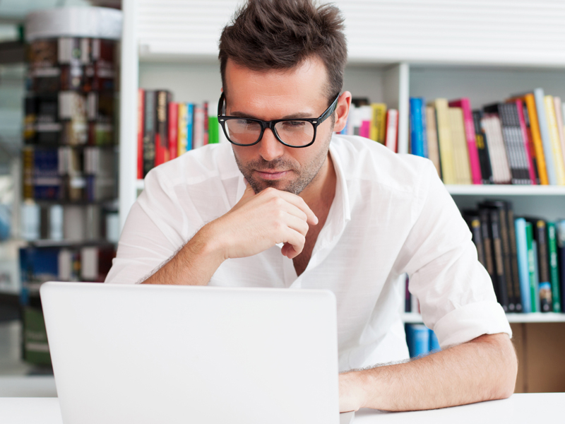 man in laptop thinking about tax