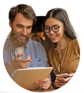 man and woman checking a file