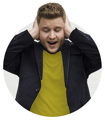 man with hands covering his ears