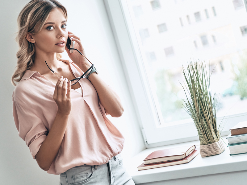 woman talking with someone over the phone