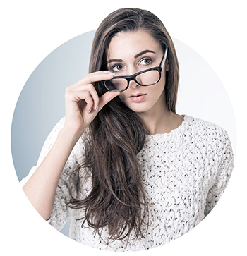 Young woman taking off glasses, question, gray