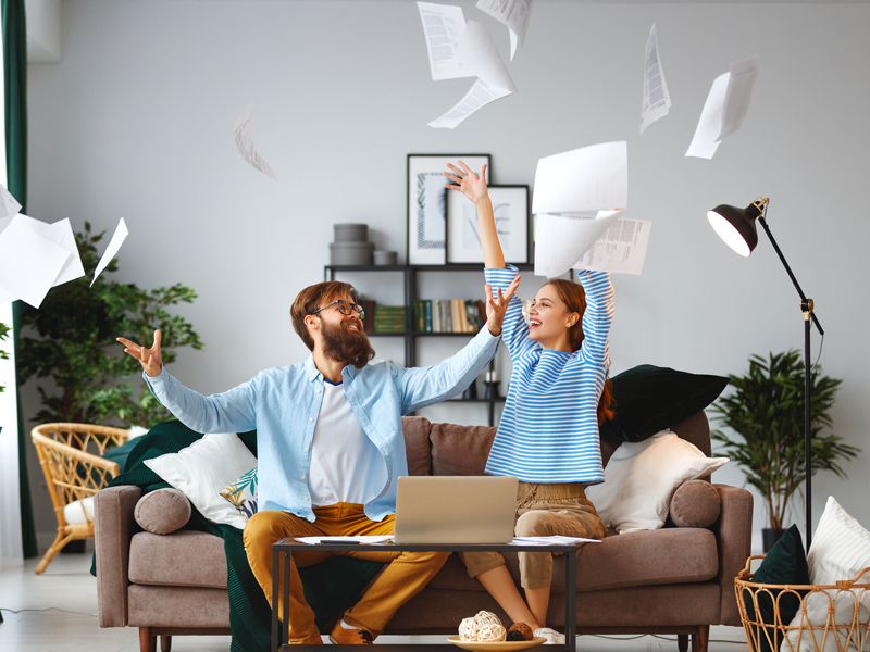 two people happy with flying and scattered papers